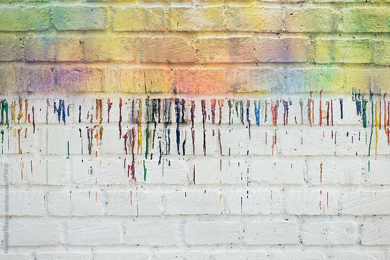 Raining Colours on a White Brick Wall by Nemanja Glumac for Stocksy United