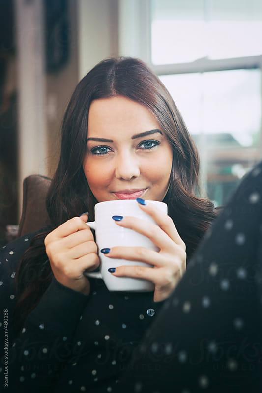 Pajamas: Pretty Woman In Onsie Having Coffee by Sean Locke for Stocksy United