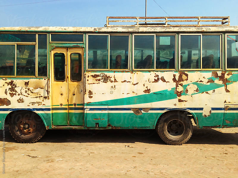 An old bus with scrape marks on the side. by Shikhar Bhattarai for Stocksy United