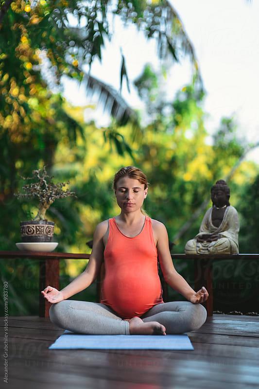 Pregnant Yoga Meditation by Alexander Grabchilev for Stocksy United