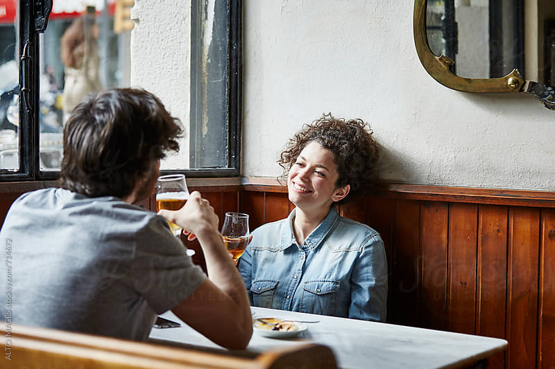 Couple Holding Wine Glasses In Restaurant by ALTO IMAGES for Stocksy United