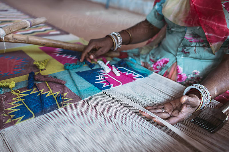 Indian woman weaves traditional carpet by Alexander Grabchilev for Stocksy United