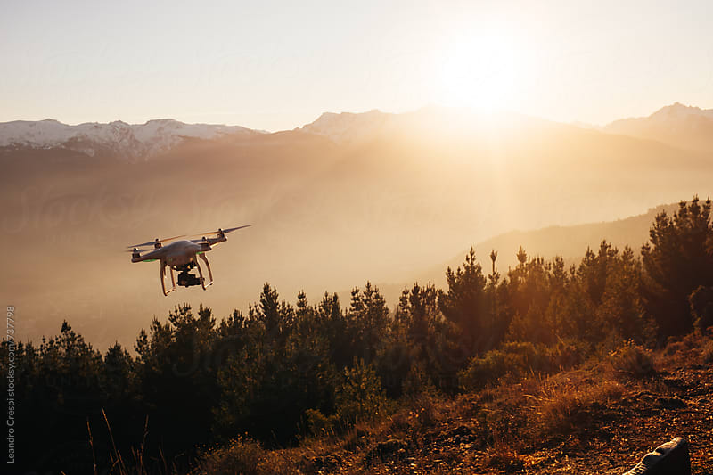 A flying drone over a mountain in Patagonia at sunset by Leandro Crespi for Stocksy United