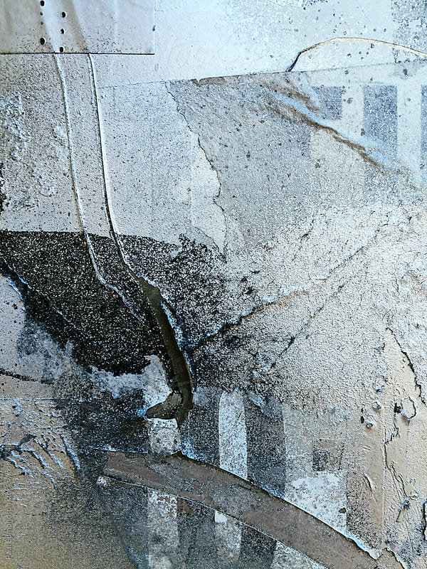 Close up of silver and metallic paint covering graffiti tags on urban wall by Paul Edmondson for Stocksy United