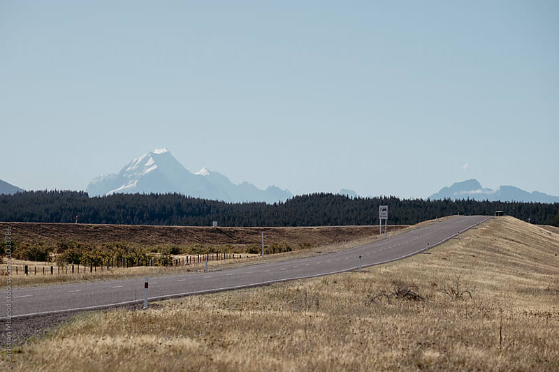 Mountains and roads. by Christian McLeod Photography for Stocksy United
