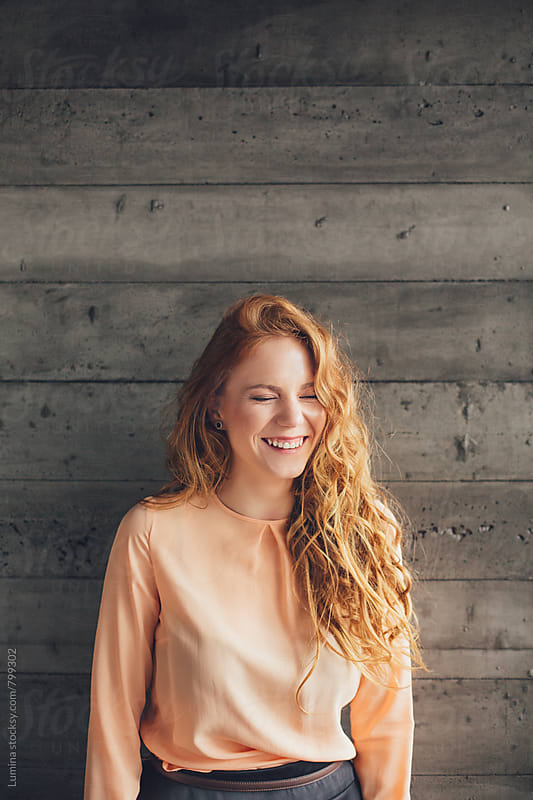 Portrait of a Smiling Ginger Woman by Lumina for Stocksy United