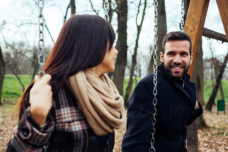 Couple Swinging on a Winter Day by Mosuno for Stocksy United