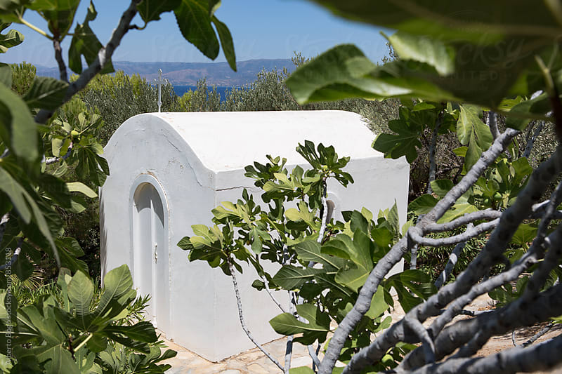 White small church at Hydra. by Alberto Bogo for Stocksy United