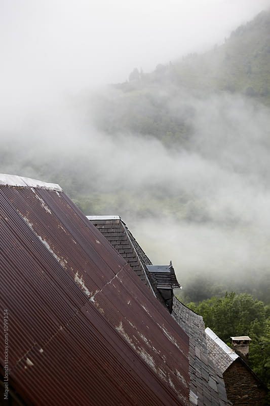 Detail of metallic and slate roofs in a mountain village by Miquel Llonch for Stocksy United