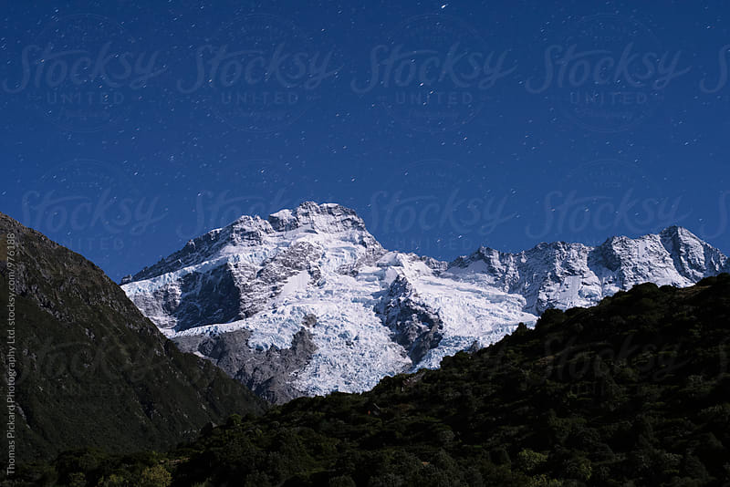 Mt Sefton lit up by moonlight, Aoraki / Mt Cook National Park, N by Thomas Pickard for Stocksy United
