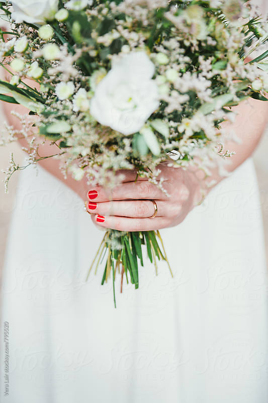 Bride and white bouquet by Vera Lair for Stocksy United