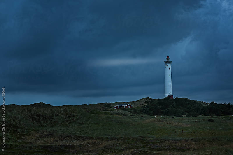 Lighthouse and little red house by Photographer Christian B for Stocksy United