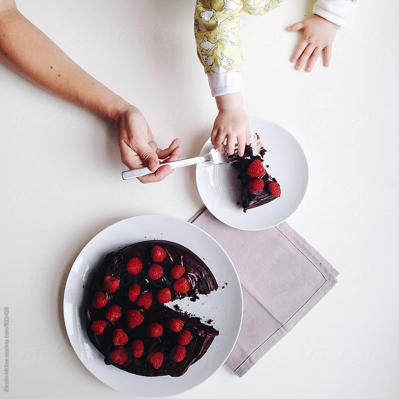 Mother and daughter eating chocolate and raspberry cake by Kirstin Mckee for Stocksy United