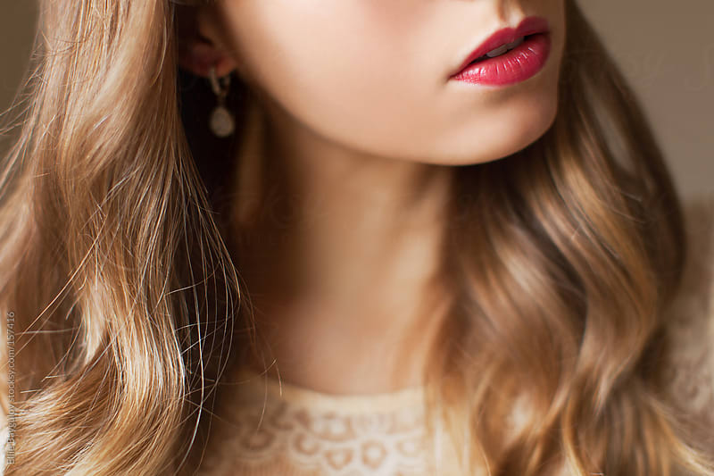 Close up of woman's lips by Ellie Baygulov for Stocksy United
