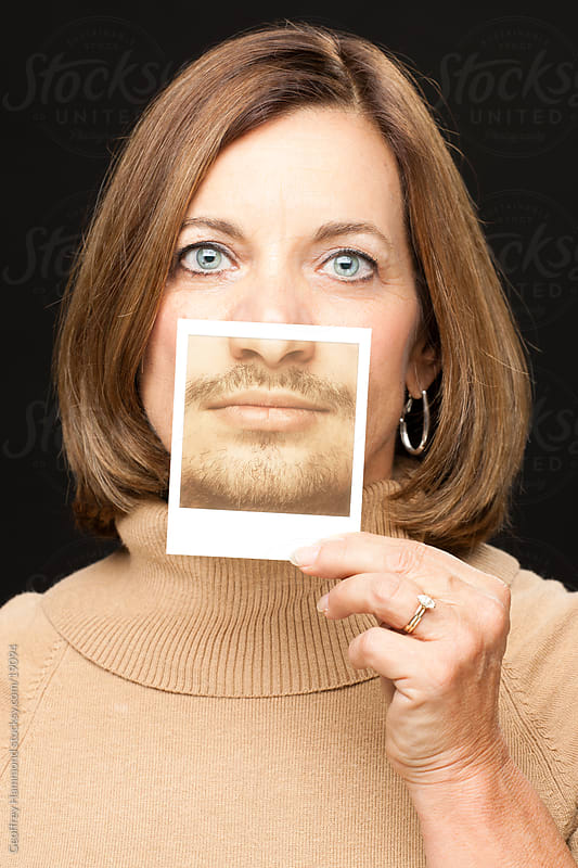Movember Supporter - Woman with Polaroid of Mustache by Geoffrey Hammond for Stocksy United