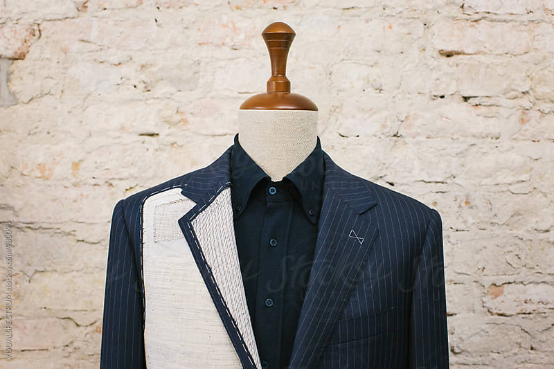 Close Up of Expensive Blue Pinstripe Suit on Hanger Stand  by Julien L. Balmer for Stocksy United