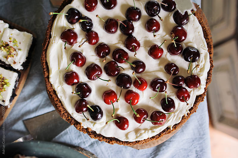 Fresh cherry pie by Adrian Cotiga for Stocksy United