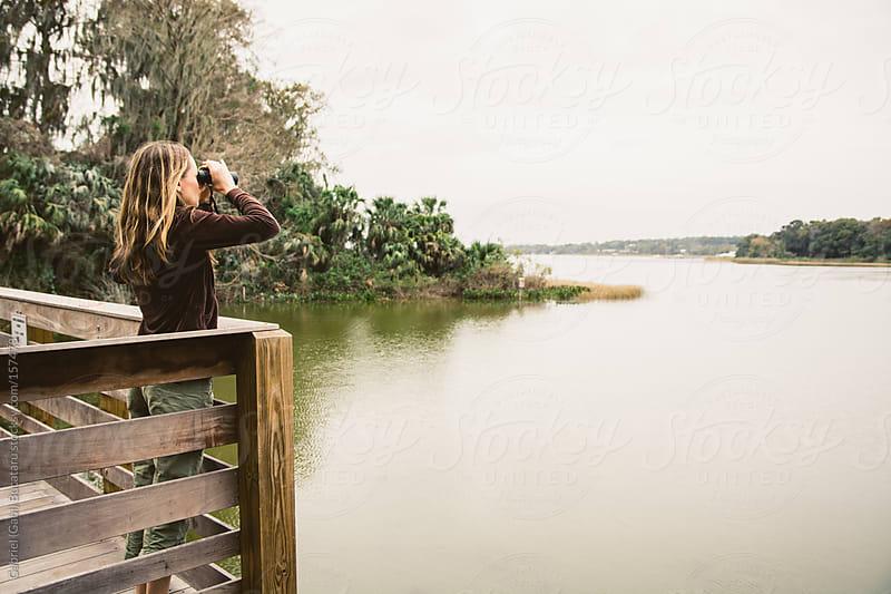 Woman Birdwatching by Gabriel (Gabi) Bucataru for Stocksy United