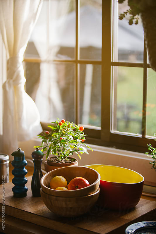 Fruit Bowl in the Kitchen with Morning Light Coming Through the Window by VICTOR TORRES for Stocksy United