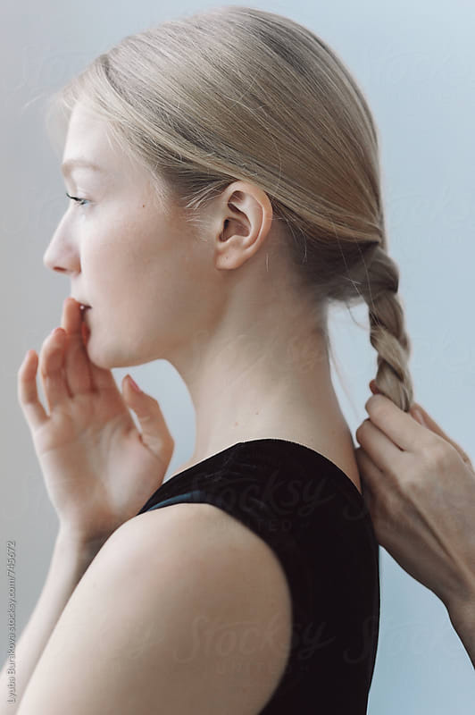 Making a braid  by Lyuba Burakova for Stocksy United