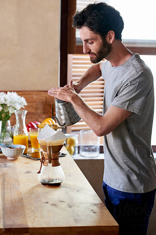 Man preparing morning coffee by Daxiao Productions for Stocksy United
