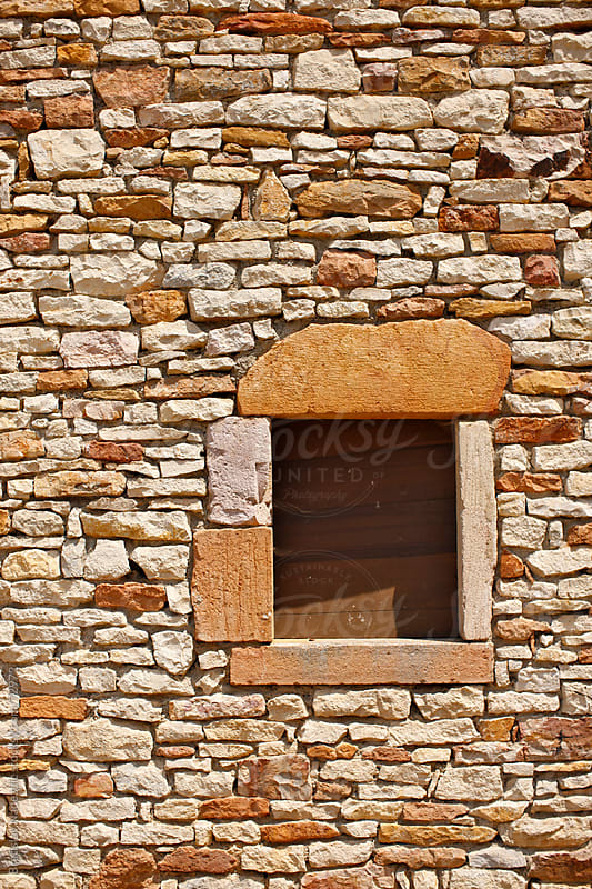 Window on old stone wall by Bratislav Nadezdic for Stocksy United