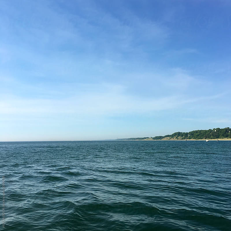 Looking Across Lake Michigan On A Clear Summer Day by ALICIA BOCK for Stocksy United