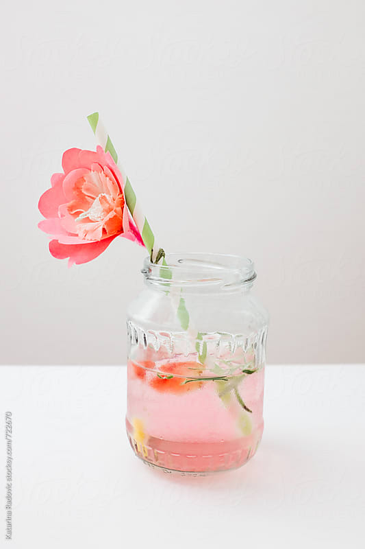 Ice Tea Jar wit Paper Flower Decoration by Katarina Radovic for Stocksy United