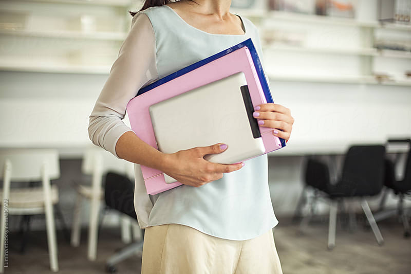 Businesswoman Holding Files and a Tablet by Lumina for Stocksy United