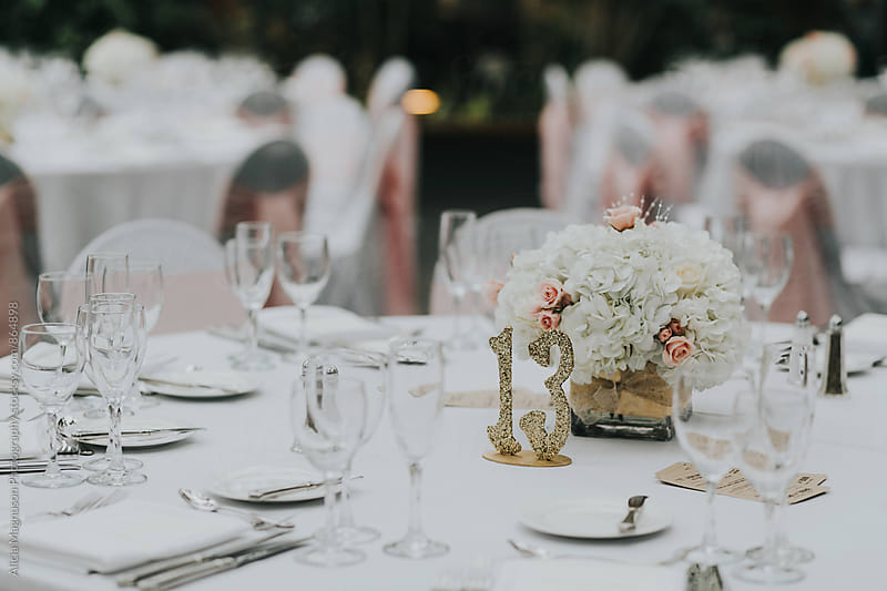 Table Set for Wedding Reception by Alicia Magnuson Photography for Stocksy United