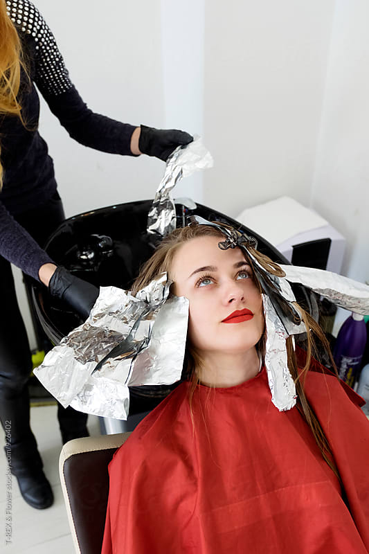 Woman with foil on hair at barberhsop by T-REX & Flower for Stocksy United