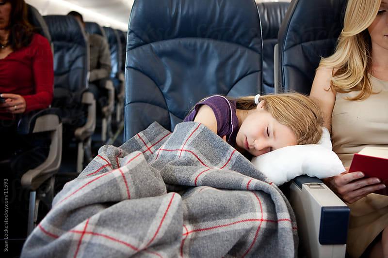 Airplane: Little Girl Sleeping on Plane by Sean Locke for Stocksy United