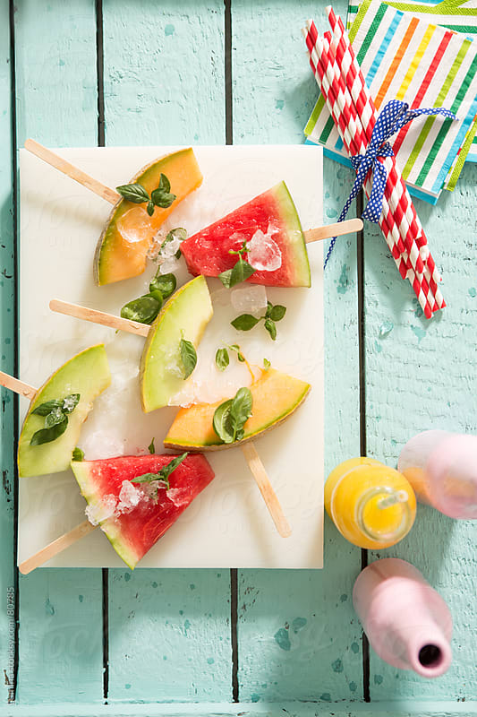 Melon and Watermelon Slices on Sticks by Lumina for Stocksy United