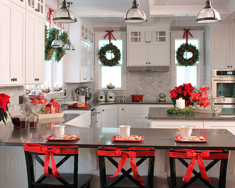 Kitchen decorated for Christmas by Daniel Hurst for Stocksy United