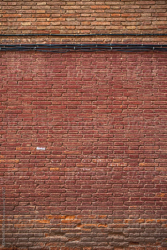 Red brick wall.  by BONNINSTUDIO for Stocksy United