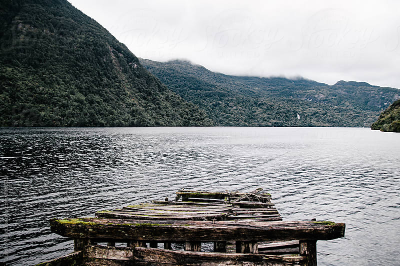 Weathered abandoned pier on a remote lake in Southern Chile by Justin Mullet for Stocksy United
