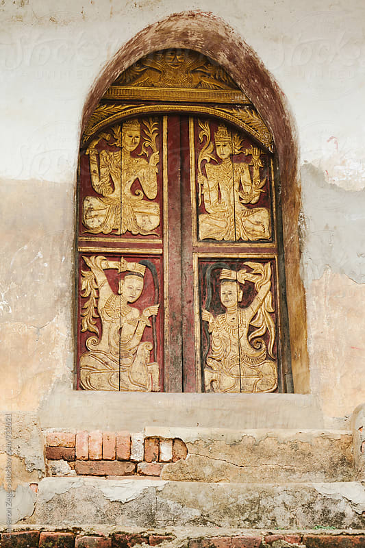 temple door in Burma by Cameron Zegers for Stocksy United