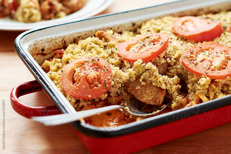 Gratin of cauliflower, tomatoes, vegan chicken pieces and quinoa  by Harald Walker for Stocksy United