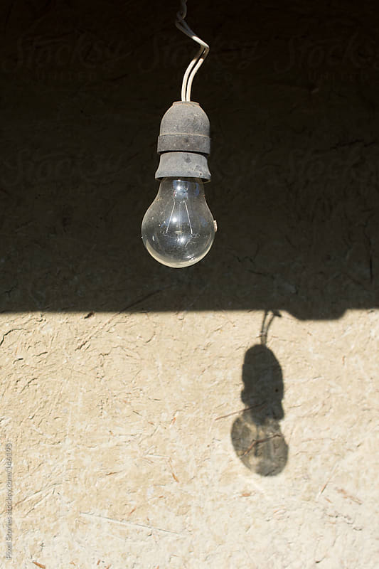 Old light bulb by Pixel Stories for Stocksy United