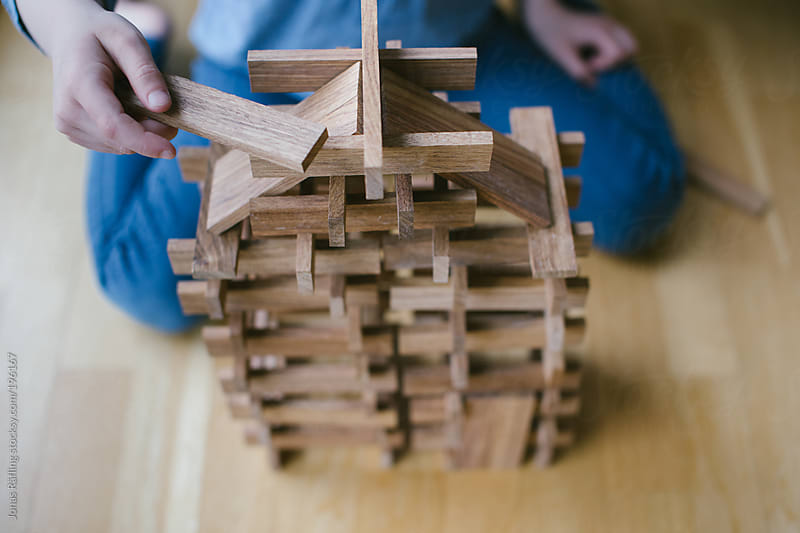 Child building a house by Jonas Räfling for Stocksy United