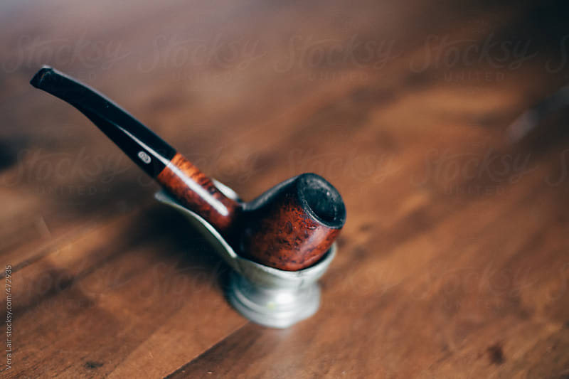 Old wooden pipe by Vera Lair for Stocksy United