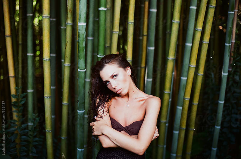 Portrait of the woman among bamboo  by Lyuba Burakova for Stocksy United