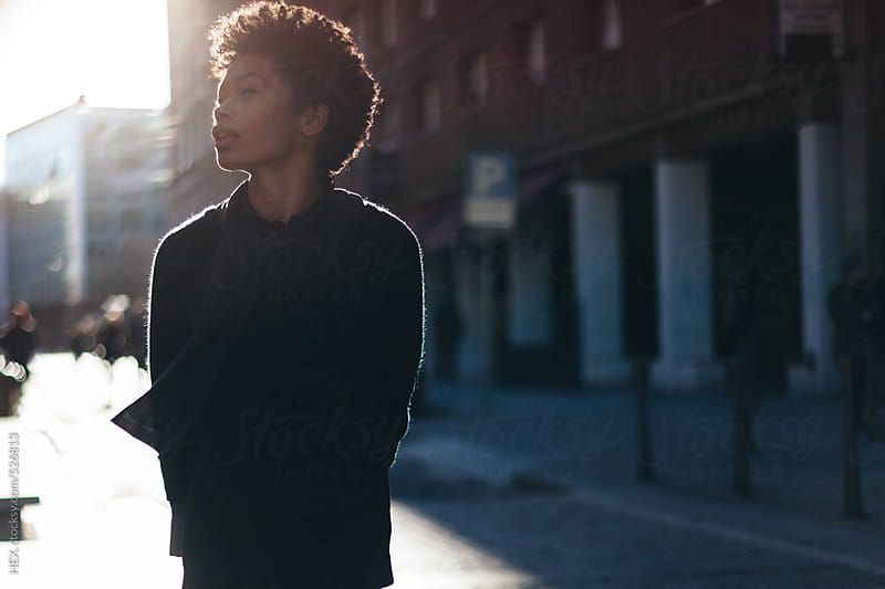 Young Pretty Afro Woman Walking in the Street  by HEX. for Stocksy United
