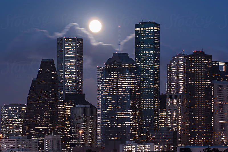 Full moon and office lights of downtown Houston at night by yuko hirao for Stocksy United