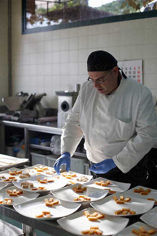 Chef preparing spanish christmas dessert for a feast by Miquel Llonch for Stocksy United