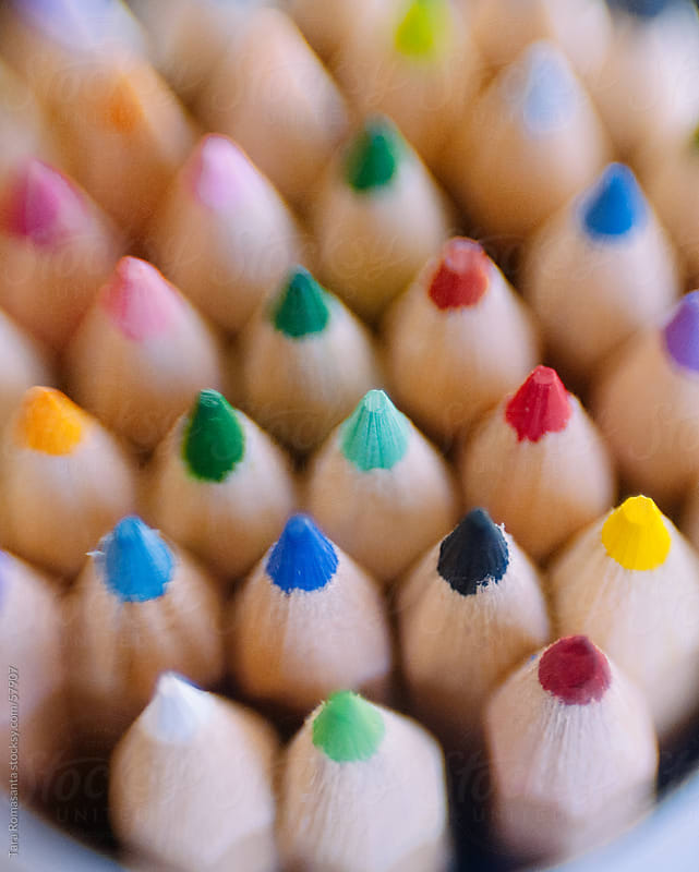 colored pencils pointing up by Tara Romasanta for Stocksy United
