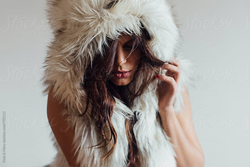Portrait of woman with fur by Kate & Mary for Stocksy United