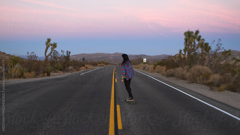 Woman Longboarding at Sunset by MEGHAN PINSONNEAULT for Stocksy United