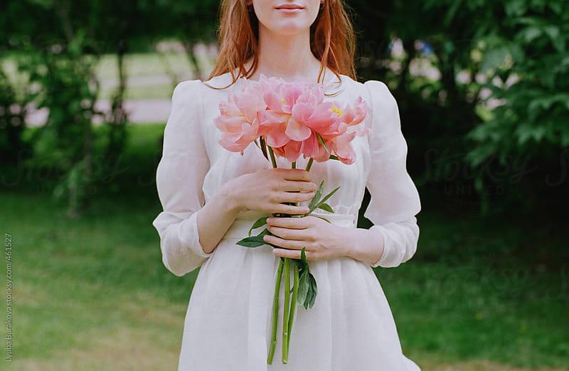 Bride holding on a peony bouquet  by Lyuba Burakova for Stocksy United