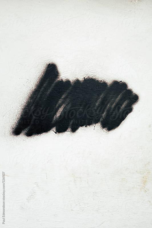 Black spray paint on wall exterior by Paul Edmondson for Stocksy United